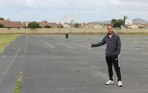 P.E. teacher Ignacio Flores demonstrates where the new multipurpose room will be built.