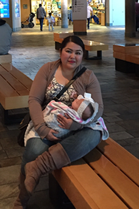 Tiffany Ayala with her adopted baby, Melody Rose, at the Monterey Bay Aquarium.