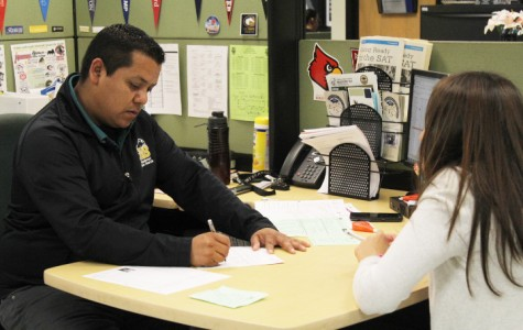 Ignacio Aguilera, Educational Advising Specialist, helps out an ETS student go over her A-G requirements in order to be on track to graduate.