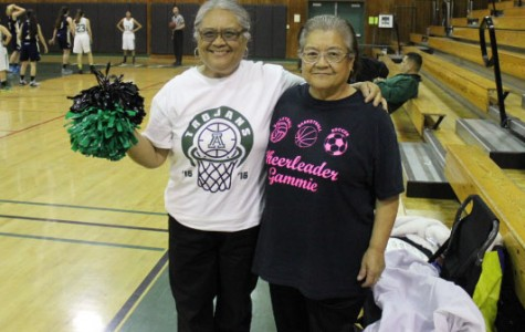 "Leonie Lear Alisal class of 1969 and Julie Irinco Salinas class of 1966, pose before the girls' basketball game. ""We enjoy cheering for both boys' and girls' teams,"" they said."