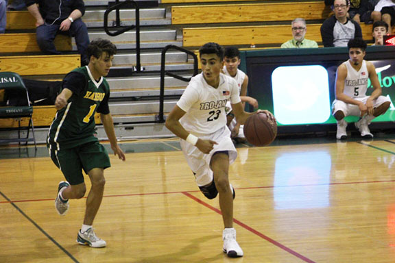 Josue Gil looks to drive against his defender in the win against Harbor High School in December.