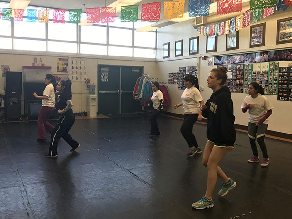 All Girls Workout Camp being led by Dalilah Alvarado for the zumba class with Ms. Baldwin dancing side by side with them.