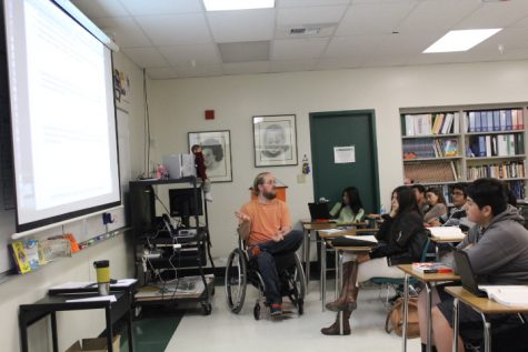 "Junior AP teacher, Brad Ashby, prepares his students on what to expect for the AP U.S History test. Junior Ana Torres said, ""I feel like this class helped me in a way because it definitely helped me see how college work would be. He made us write a lot, and gave us timed writing. His advice really helped prepare us for the AP test."""