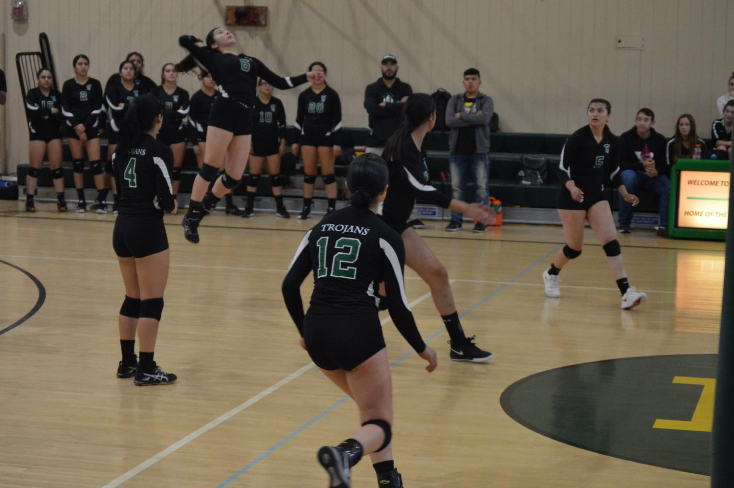 At the away game versus Monterey, captain Yesenia Tjierina is seen attacking the ball with another kill.