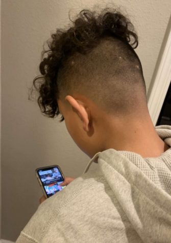 My 14 year old cousin using his iPhone 11  scrolling through YouTube searching for a video to watch.
