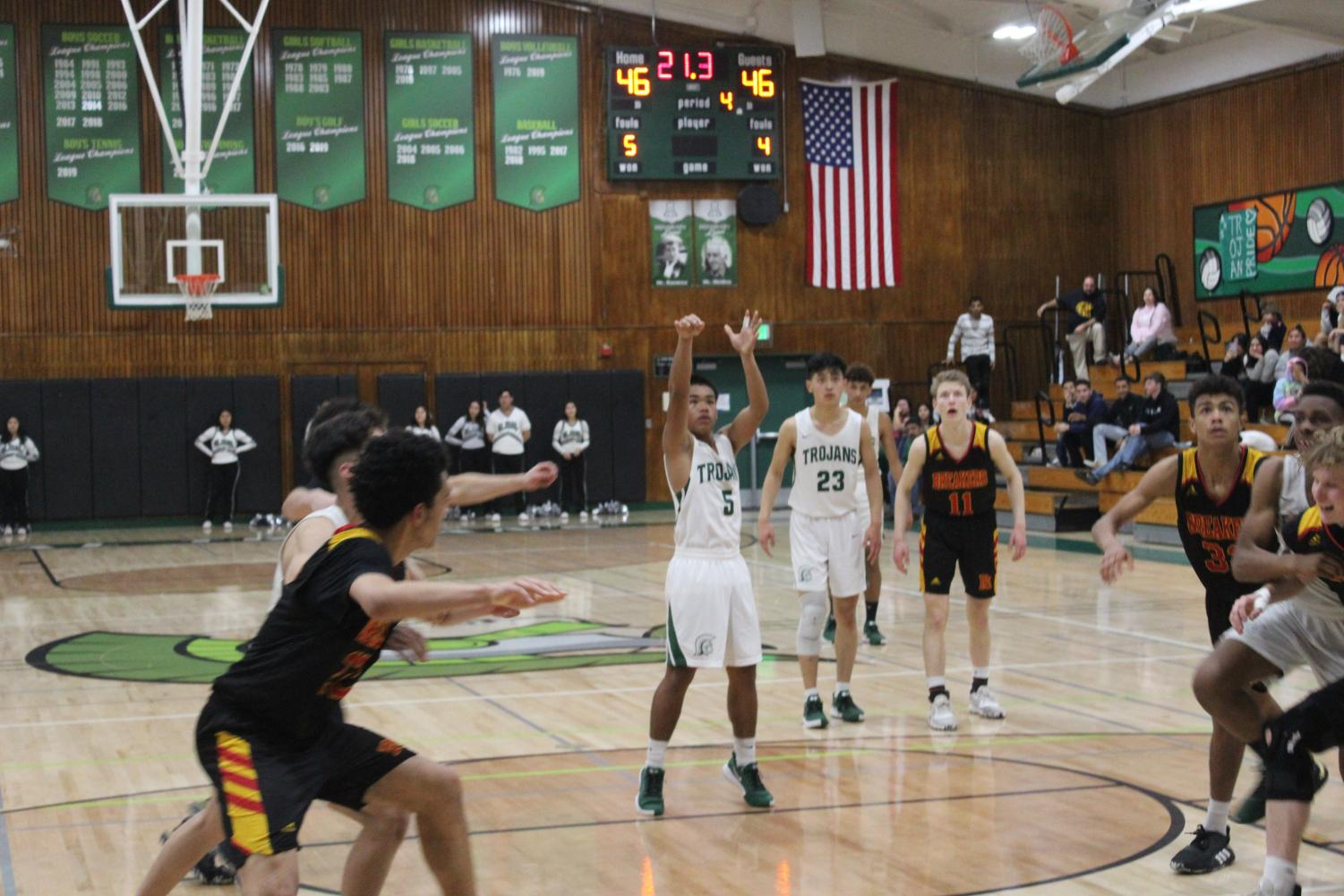 Junior guard Jopel Gaveria, making two free-throws to bring up the score to 47-46 with 21.3 seconds left. Trojans play tough defense on the other end to win the game .