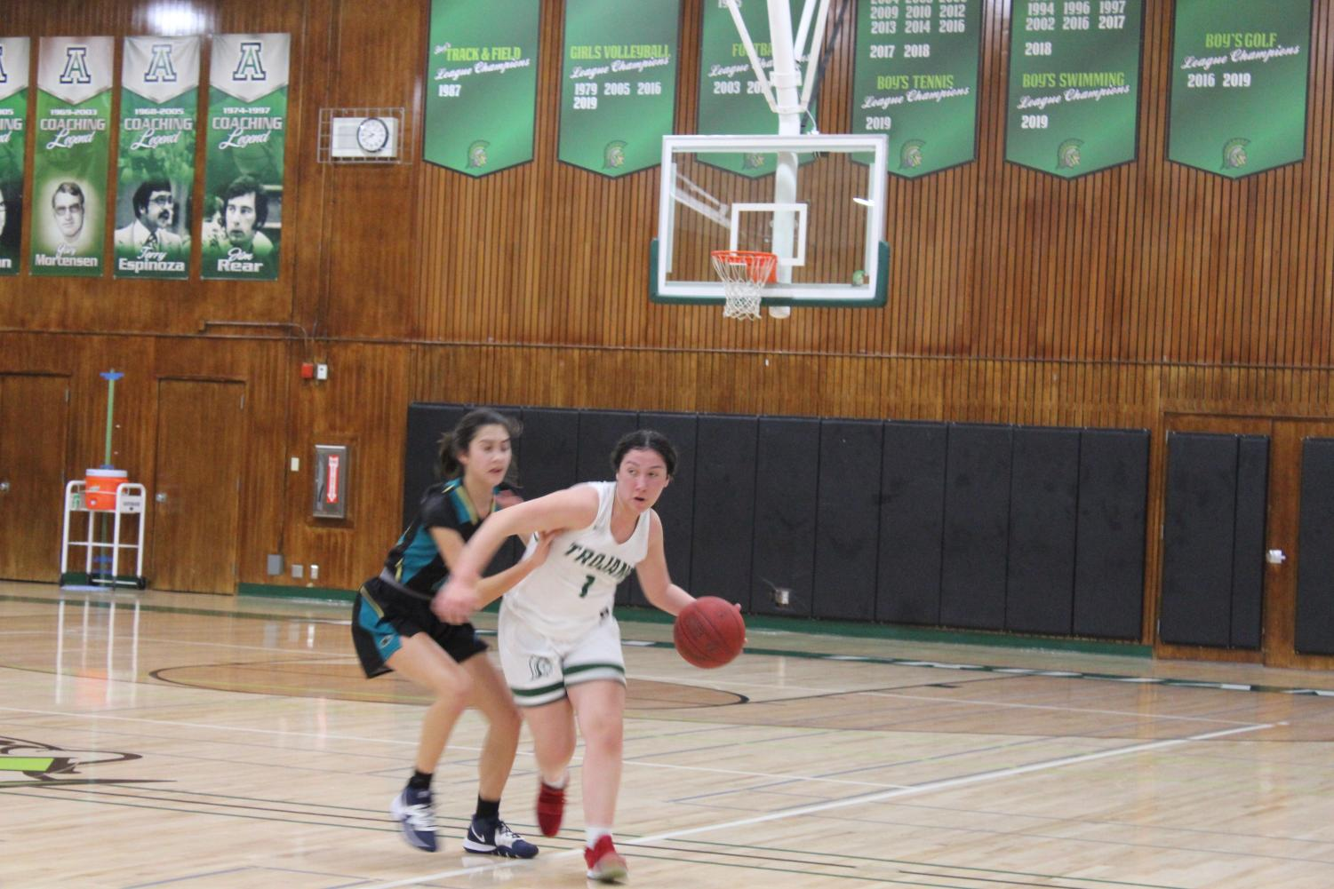 Briana Mejia drives to the basket against Christopher in the Trojans' 54-47 victory on 1/28/2020. The victory put the team firmly in first place at 5-0.