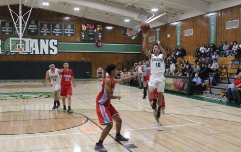 "Senior Nicholas Enriquez makes a floater against North High. Alisal won the game 73-42. ""It felt good to be back on the floor after a year and to be playing with my brothers,"" said Enriquez."