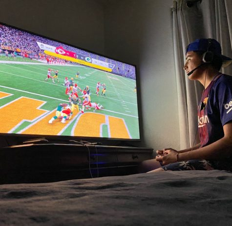 Senior Luis Tena playing his favorite game Madden to pass the time.