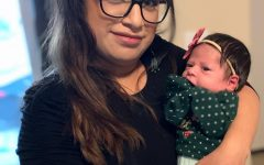 English teacher Mireya Gutierez holding her daughter. Gutierez's main goal is to keep her daughter safe,