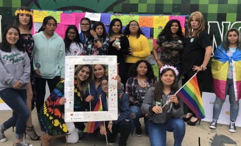 "During Ally Week in October 2017, members of the Be Yourself Club pose in front of messages of support for the LGBTQ+ community. Club adviser Jaqui Gallardo said the group has continued to grow despite the pandemic. ""They"