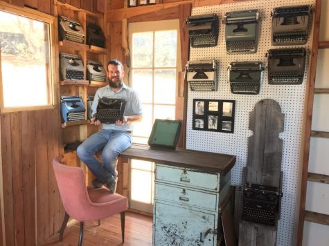 Mr. Dixon showcasing his typewriter collection in the shed he built over the summer for them.