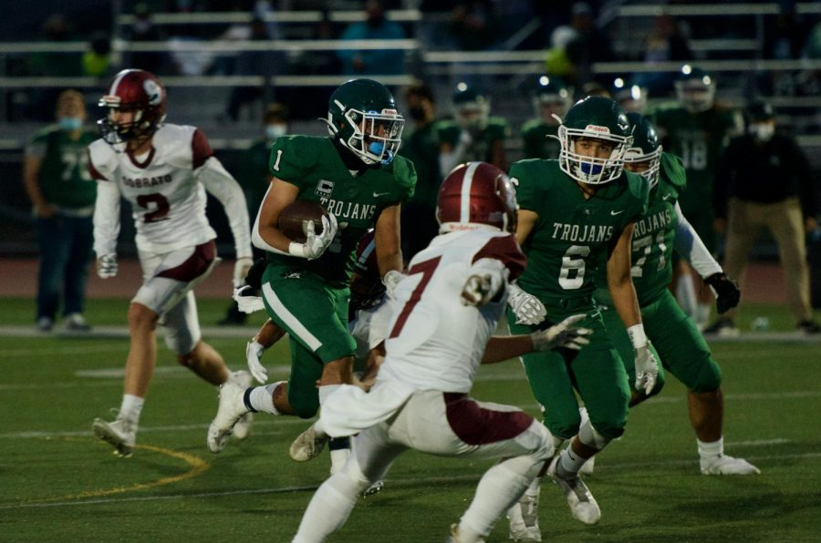 """Running back Christian Campos scampers for 20 yards in the 38-12 victory over Ann Sobrato on September 12, Campos said, """"We knew what we were supposed to do coming into the game, and we all performed."""""""