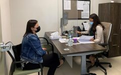 Caption for picture: Maria Coyt , a SSW intern. consults with Lorena Sanchez about a curriculum to begin a coping skills therapeutic group. We have groups available (i.e. grief/loss, coping skills, empowerment, etc.) and also able to provide individual counseling if needed, Sanchez said.